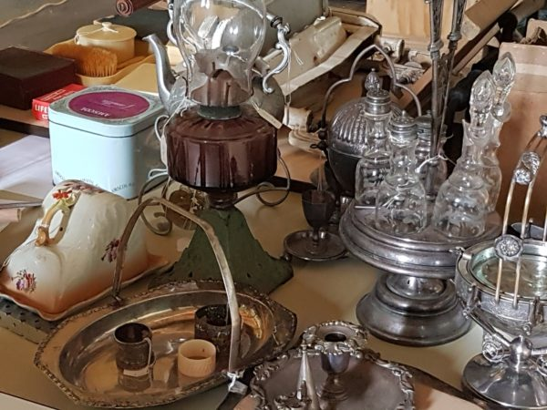 Display of old household objects on a table